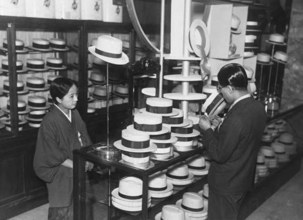 Straw Hat Photograph - Hat Buying by Fox Photos