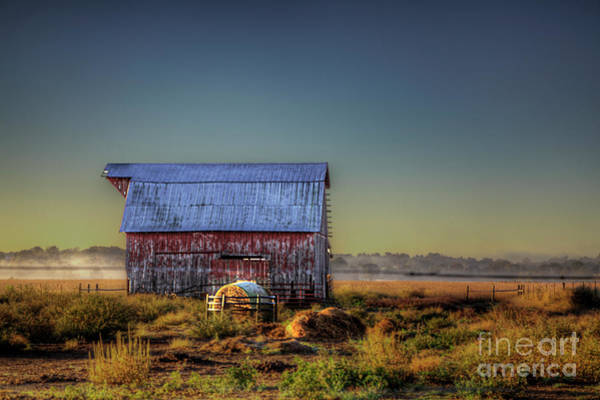 Wall Art - Photograph - Hay Bale By A Barn At Dawn.  by Larry Braun