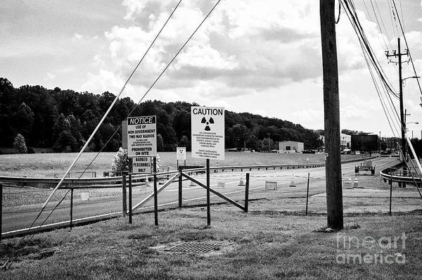 Wall Art - Photograph - hazardous radation warning signs at the entrance to the Y-12 complex in the former secret city of Oa by Joe Fox