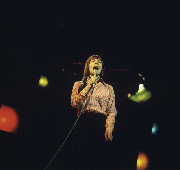 Photograph - Helen Reddy Performs On Stage by David Redfern