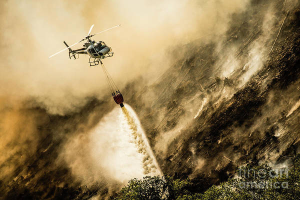 Photograph - Helicopter Dropping Water On A Forest Fire by Keith Morris
