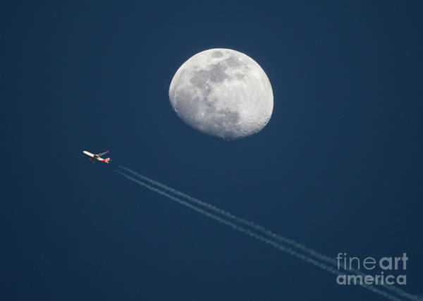 Photograph - High Altitude Airliner And Gibbous Moon by Kevin McCarthy