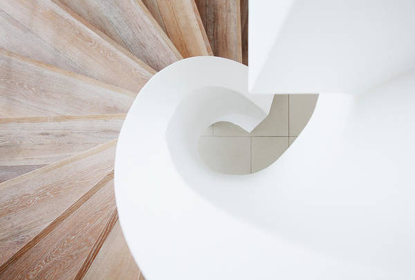 Home Interior Photograph - High Angle View Of Curving Staircase by Martin Barraud