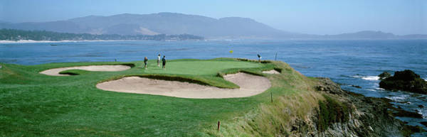 Pebble Beach Golf Course Photograph - High Angle View Of People Playing Golf by Panoramic Images