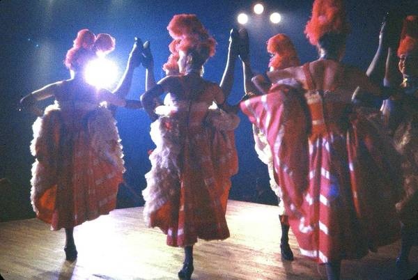Photograph - High-kicking French Cancan Dancers Perfo by Loomis Dean
