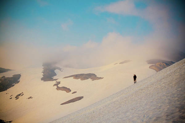 Snowfield Photograph - Hiker Crosses Snowfield by Christopher Kimmel