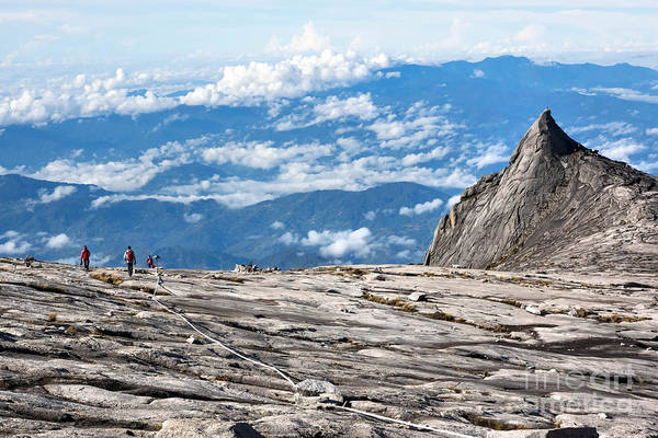 Exploration Wall Art - Photograph - Hikers At The Top Of Mount Kinabalu In by R.m. Nunes