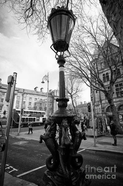 Wall Art - Photograph - hippocampus lamp cast iron lamp standard college green Dublin Republic of Ireland Europe by Joe Fox