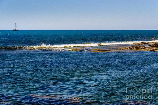 Photograph - Holiday Background In The Sea With A Sailboat In The Distance On by Joaquin Corbalan