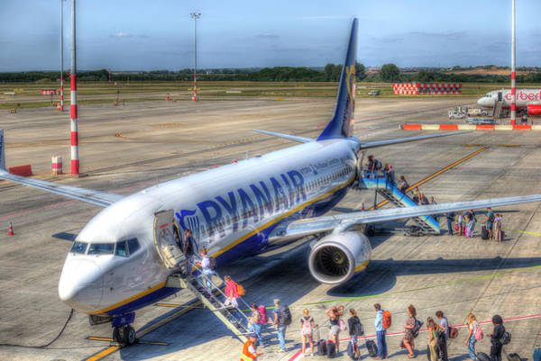 Wall Art - Photograph - Holidaymakers Boarding Airliner by David Pyatt