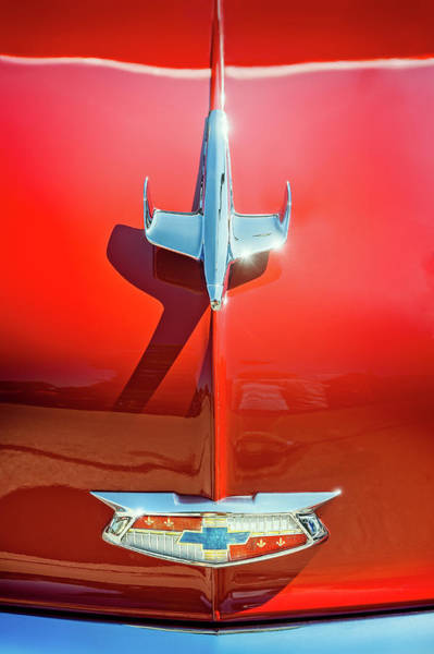 Vehicles Wall Art - Photograph - Hood Ornament On A Red 55 Chevy by Scott Norris