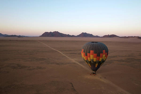 Wall Art - Photograph - Hot-air Balloon Is Ready For Take-off At Dawn Aerial View Kulala Wilderness Reserve Namib Desert by imageBROKER - Thomas Dressler