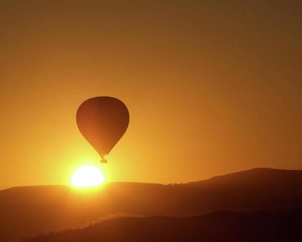 Cappadocia Photograph - Hot-air Balloon Over Rising Sun by Wu Swee Ong