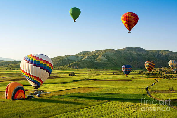Wall Art - Photograph - Hot Air Balloons Fly Over Cappadocia Is by Olena Tur