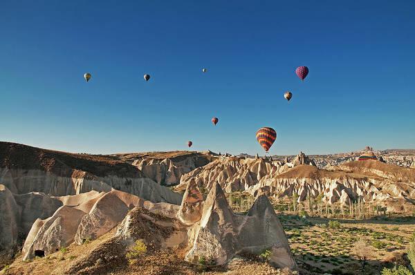Cappadocia Photograph - Hot Air Balloons Over Cappadocia by Korhan Sezer