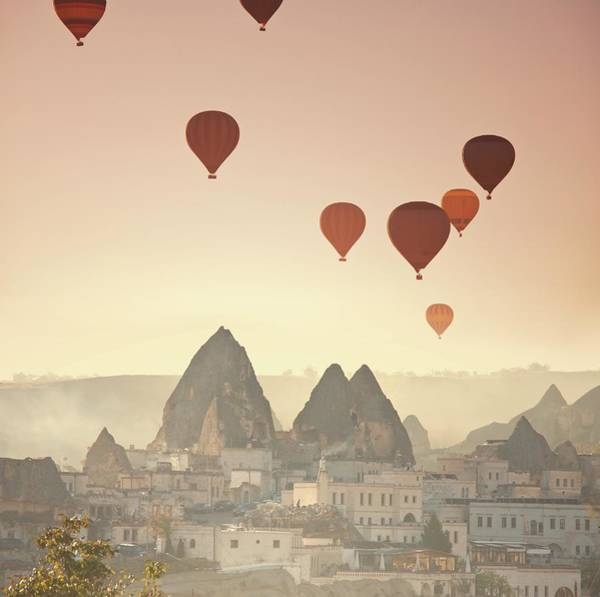 Cappadocia Photograph - Hot Air Balloons Over Town by Ingram Publishing