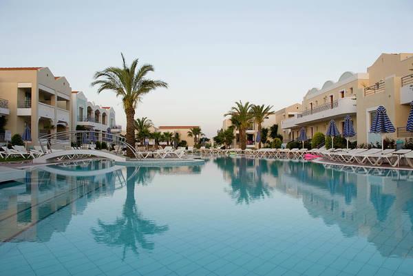 Armchair Photograph - Hotel Swimming Pool At Dawn by Pidjoe