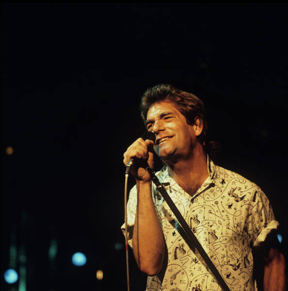 Photograph - Huey Lewis Performs On Stage by David Redfern