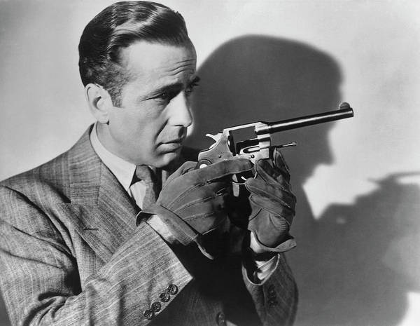 Wall Art - Photograph - Humphrey Bogart With A Gun by Archive Photos