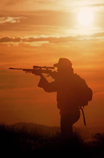 Rifle Photograph - Hunter With Sunset Background by Bob Winsett