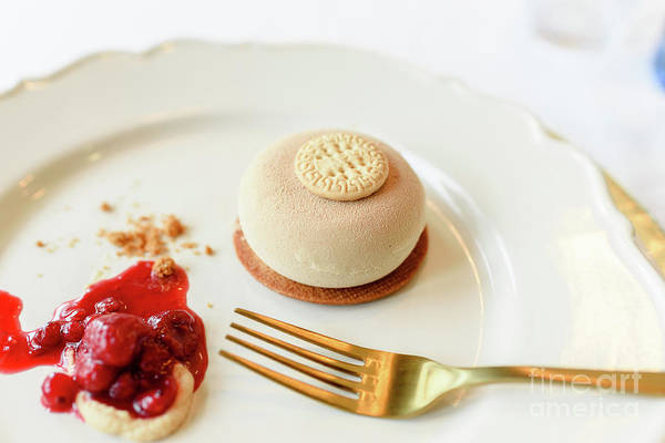 Photograph - Ice Cream Dessert With Biscuit And Red Fruit Jam Elegantly Presented With Golden Cutlery And White Background. by Joaquin Corbalan