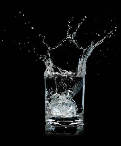 Drinking Glass Photograph - Ice Splashing Into Water Glass by Chris Stein