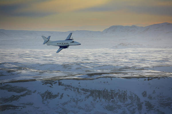 Wall Art - Photograph - Iceland, Cessna Plane Flying Over Snow by Arctic-images
