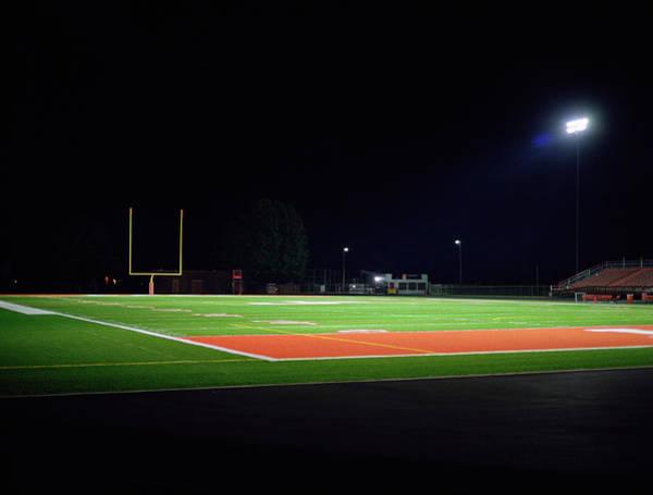 Team Sport Photograph - Illuminated American Football Field At by Darrin Klimek