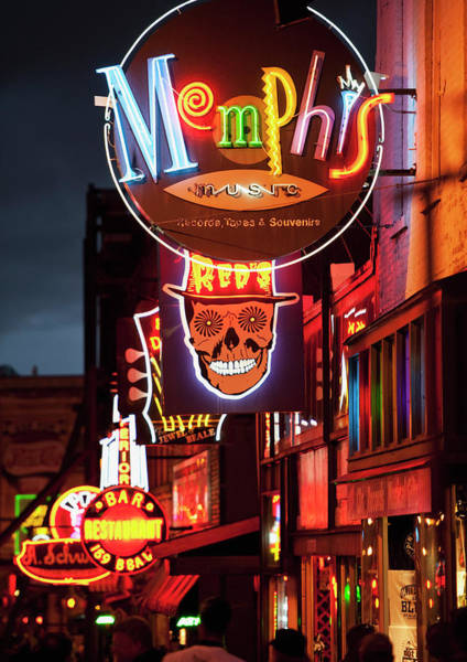 Photograph - Illuminated Bar Signs On Beale Street by Tetra Images