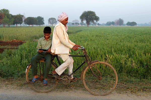 Indian Father Cycling Son To School Art Print