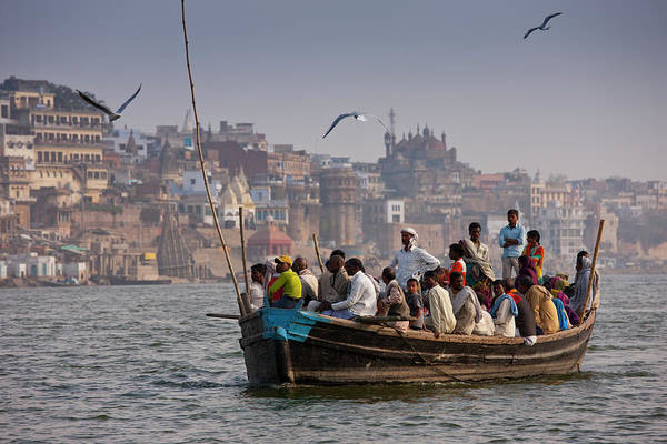 Real People Photograph - Indians Cruising River Ganges by Tim Graham