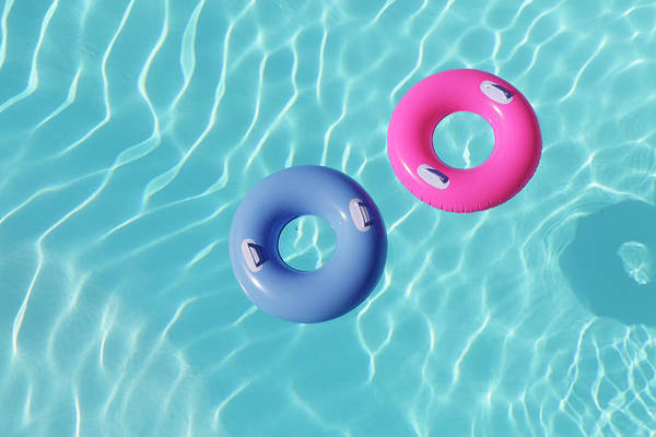 Nature Photograph - Inflatable Rings In Pool by Peter Cade