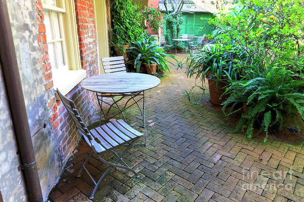 Photograph - Into The New Orleans Courtyard by John Rizzuto