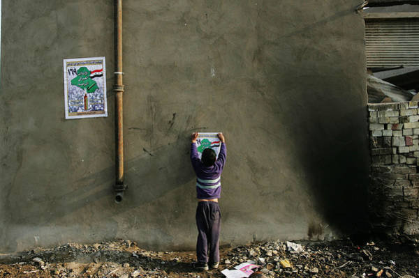 Democracy Photograph - Iraqi Shias Hang Political Posters by Chris Hondros