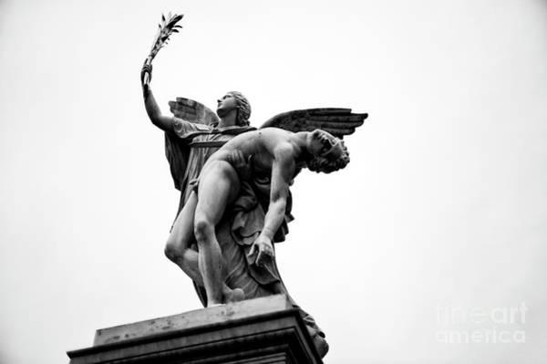 Wall Art - Photograph - Iris Takes The Fallen Hero To Olympus In Berlin by John Rizzuto