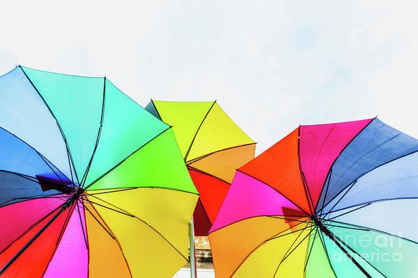 Photograph - Isolated Multicolored Open Umbrella White Background. by Joaquin Corbalan