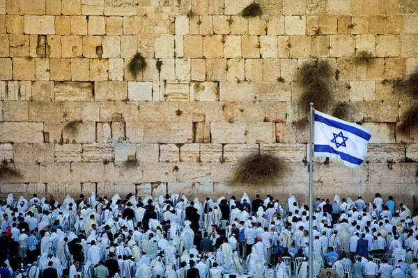 Crowd Photograph - Israeli Flag Flies At The Western Wall by Gary S Chapman