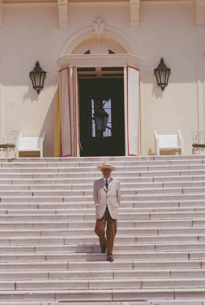 Sun Hat Photograph - Italian Hotelier by Slim Aarons