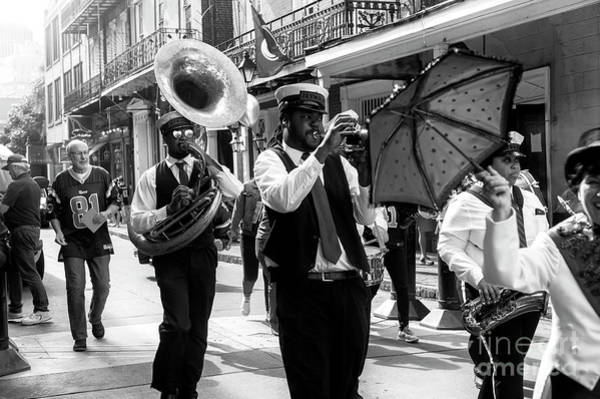 Photograph - Jaywalkers In New Orleans by John Rizzuto
