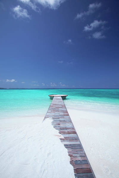 Jetty Photograph - Jetty Leading To Ocean, Maldives by Sakis Papadopoulos