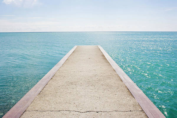 Waters Edge Photograph - Jetty by Michellegibson