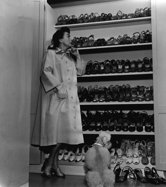 Shoe Photograph - Joan Crawford Inspects Her Shoe Closet by Hulton Archive