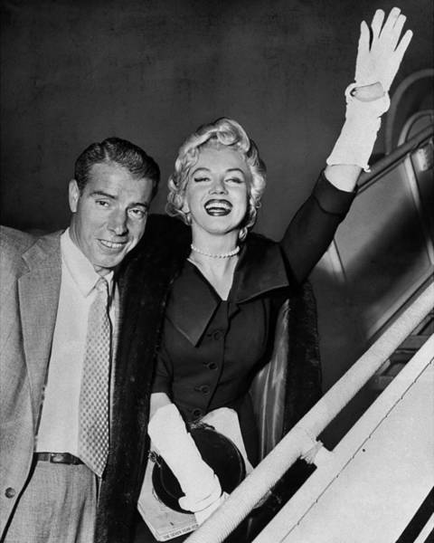 Marilyn Monroe Photograph - Joe Dimaggio And Marilyn Monroe As They by New York Daily News Archive
