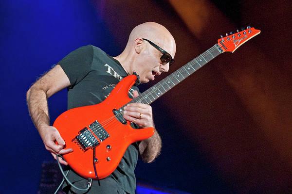 Joe Satriani Photograph - Joe Satriani Performs At Hmv by Neil Lupin