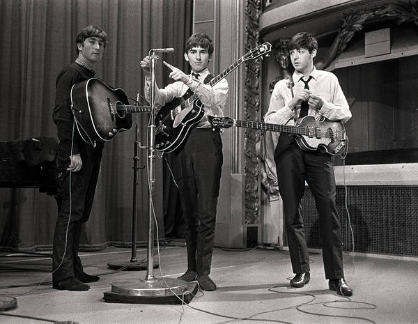 Photograph - John Lennon, George Harrison And Paul by Popperfoto