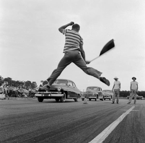 Motor Sport Photograph - Jumping Flag Man by Efield