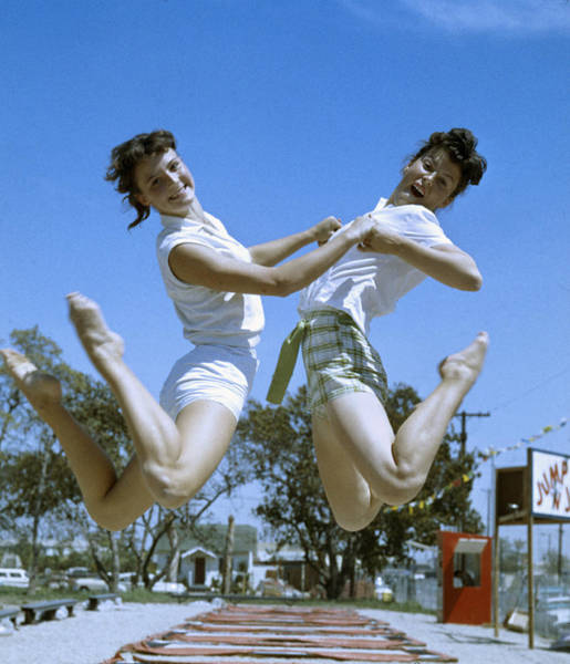 Toothy Smile Photograph - Jumping Pair by J. R. Eyerman