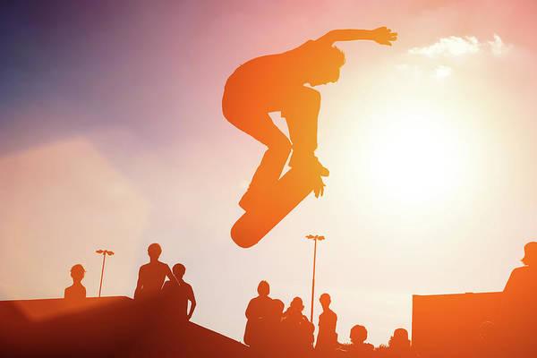 Skateboard Photograph - Jumping Skateboarder by Logoboom
