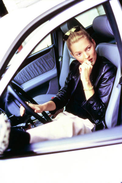 Auto Photograph - Kate Moss Sits At The Wheel Of A Car by Arthur Elgort