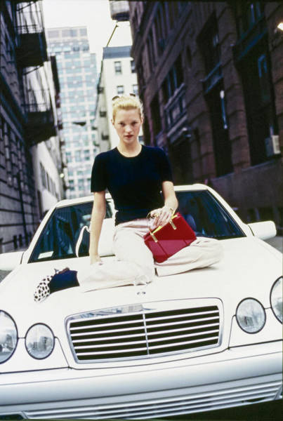 Auto Photograph - Kate Moss Sits On A Mercedes-benz Sl500 by Arthur Elgort
